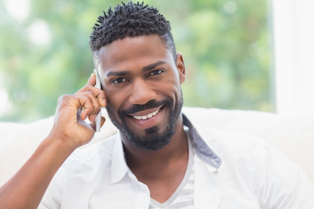 man happily taking phone call