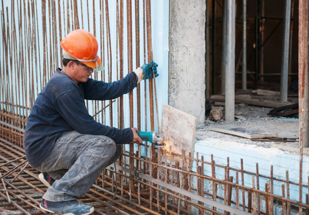 worker cutting the metal bars